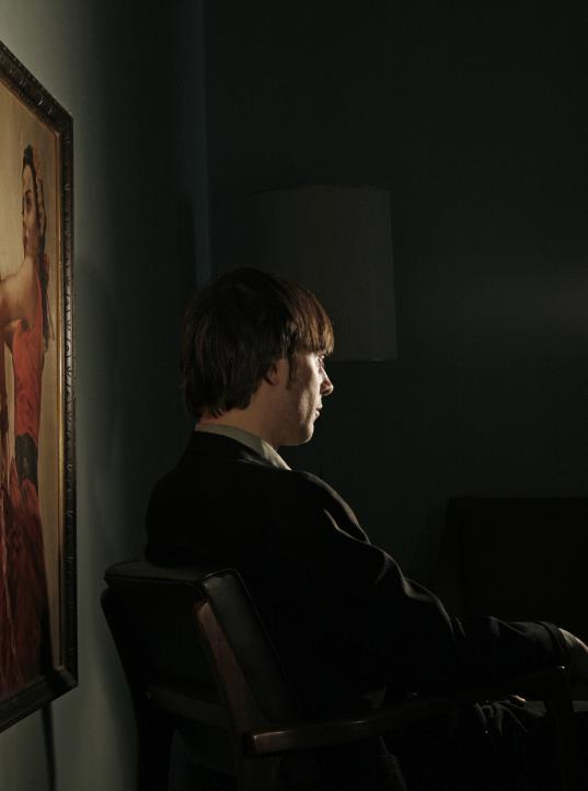portrait with old painting in dark room